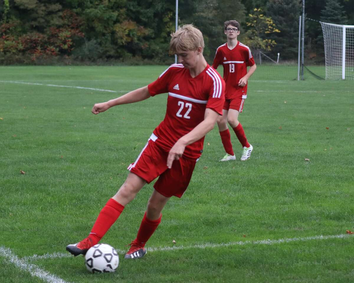 Benzie Central battles Kalkaska in boys soccer districts on Oct. 13.