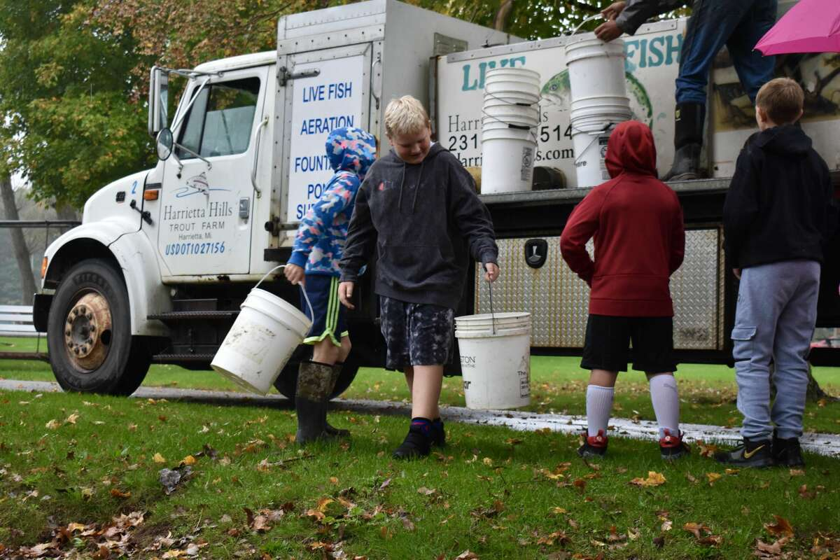 On Oct. 14, students from Big Rapids Middle School helped Harrietta Hills Trout Farm release young fish into the Muskegon River using buckets.