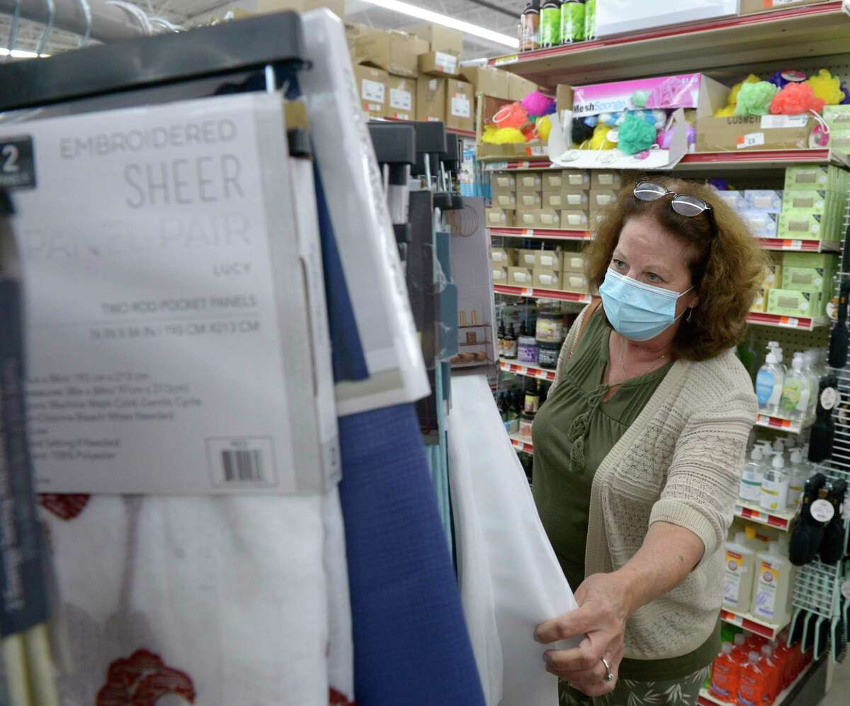 Sue Temelini, of Redding, wears a mask as she shops at Ocean State Job Lot in Danbury, Conn, on Tuesday, September 28, 2021. Danbury's mask mandate is lifted as of 12:01 a.m. Friday.