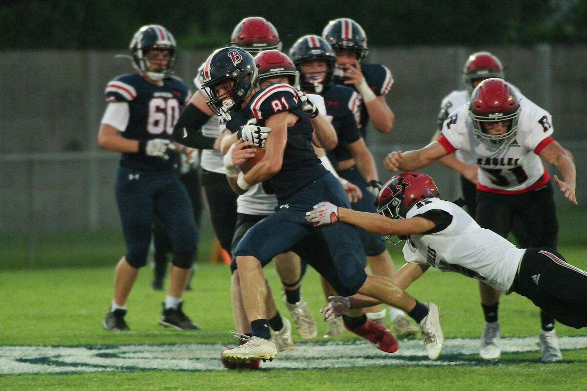 Bay Area Christian's Gannon Phillips (81) fights to break the tackles of Tomball Rosehill Christian's Grayson Bush (62) and Reid Hauser (4) Sept. 17 at Bay Area Christian High School.