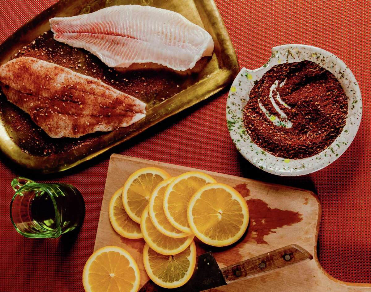 """The cocoa-orange fish by Nicole Taylor from """"Black Food"""" by Bryant Terry."""