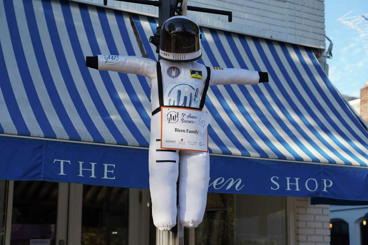 An astronaut is just one of the many scarecrows hanging from lampposts on Elm Street in New Canaan on Oct. 12, 2021.