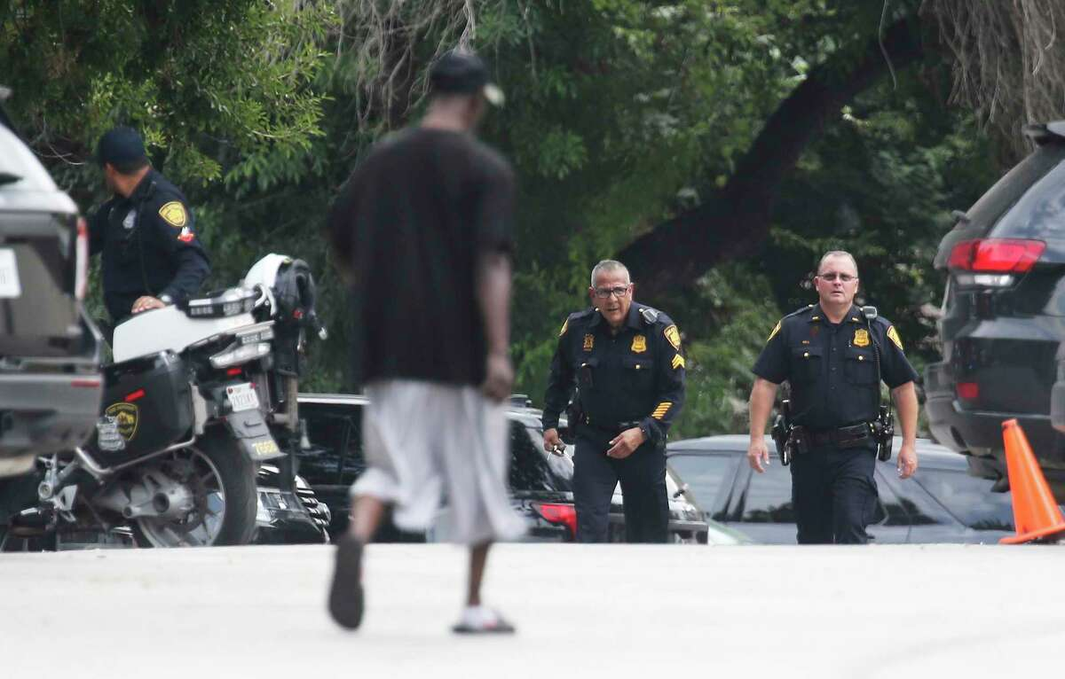 San Antonio Police Department officers tend to a standoff at Seven Oaks Apartments at 5903 Danny Kaye in the Medical Center area on Wednesday, Oct. 13, 2021.