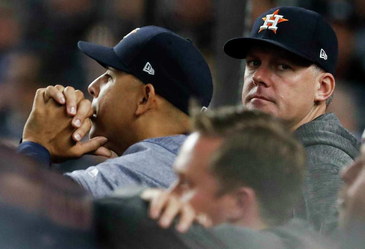 Alex Cora, Houston's former bench coach, and manager A.J. Hinch, during the 2017 ALCS against New York, will forever be linked in the Astros' sign-stealing scandal.