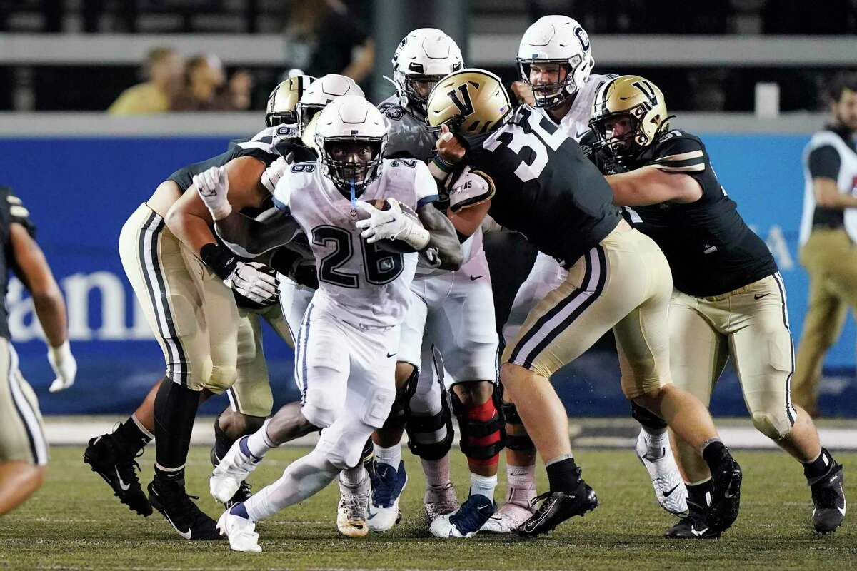 Connecticut running back Nathan Carter (26) carries the ball against Vanderbilt in the second half of an NCAA college football game Saturday, Oct. 2, 2021, in Nashville, Tenn. (AP Photo/Mark Humphrey)