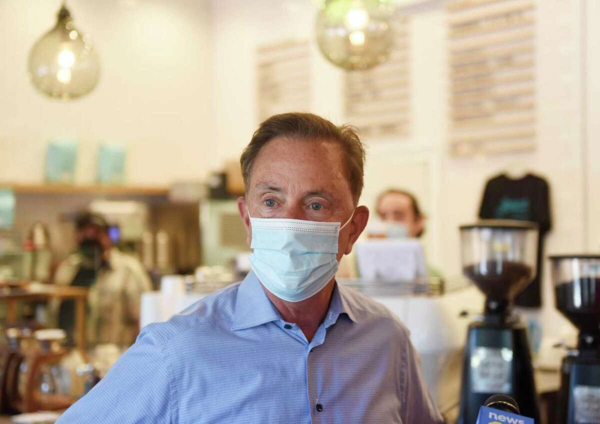Connecticut Gov. Ned Lamont visits Lorca coffee shop in Stamford, Conn. Monday, Sept. 20, 2021. Gov. Lamont visited Stamford Monday to talk with small businesses and endorse Caroline Simmons for Mayor of Stamford.