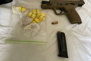 Police seized heroin, fentanyl, crack cocaine, cocaine and a gun during a raid on Spann's home Wednesday afternoon, according to police.