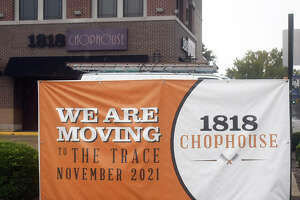 A sign sits in front of 1818 Chophouse announcing the restaurant's move next month to Trace on the Parkway.