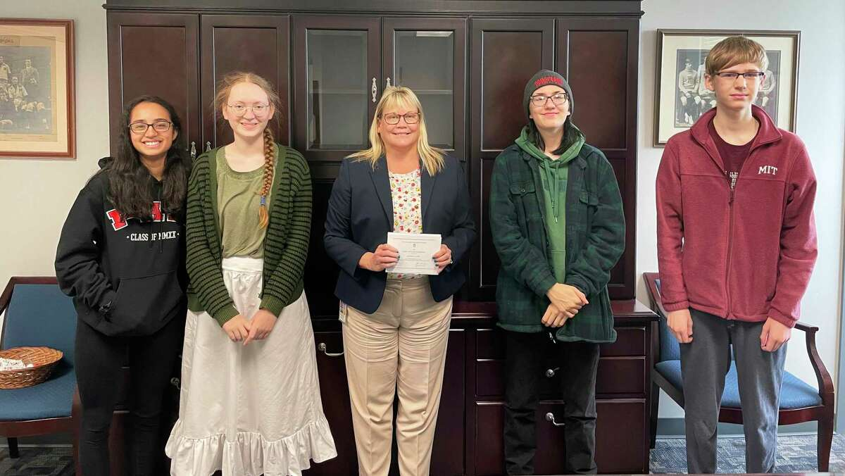 Eight Middletown High School students and the Department of School Counseling were recognized for their achievements at the recent Middletown Board of Education meeting. From left are National Merit recipients Allegra Curiel and Clara Taft, Principal Colleen Weiner, Owen Salo-Markowski and Owen DePoint.
