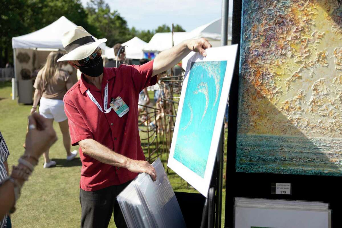 Ken Bonner, painter, speaks about his work during The Woodlands Waterway Arts Festival, Saturday, April 10, 2021, in The Woodlands. Bonner has featured work all around the world, including in Japan and New Zealand.