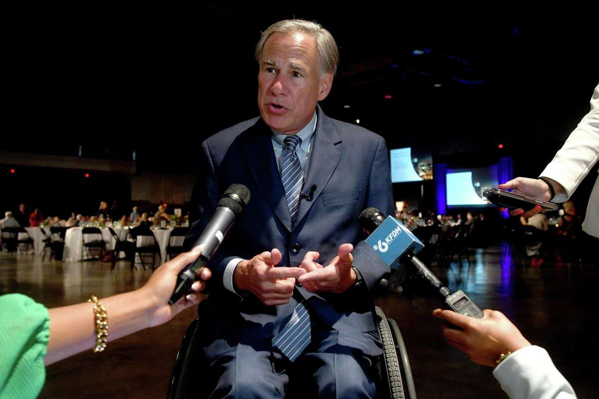 Governor Greg Abbott stops to briefly field questions before taking the stage as the keynote speaker at the annual Beaumont Chamber of Commerce's meeting. Photo made Tuesday, October 12, 2021 Kim Brent/The Enterprise