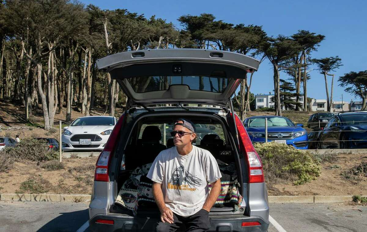 Robert Heilman checks out the view from the Lands End parking lot, where parking is now free, but that might change.