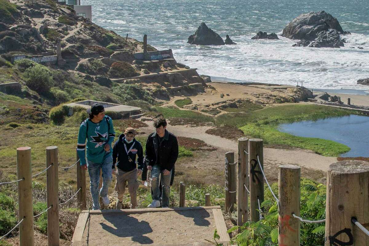 People make their way up to the Lands End parking lot from Sutro Baths in San Francisco. The Golden Gate National Recreation Area is considering charging parking fees at some park sites, including the parking lots at Lands End.
