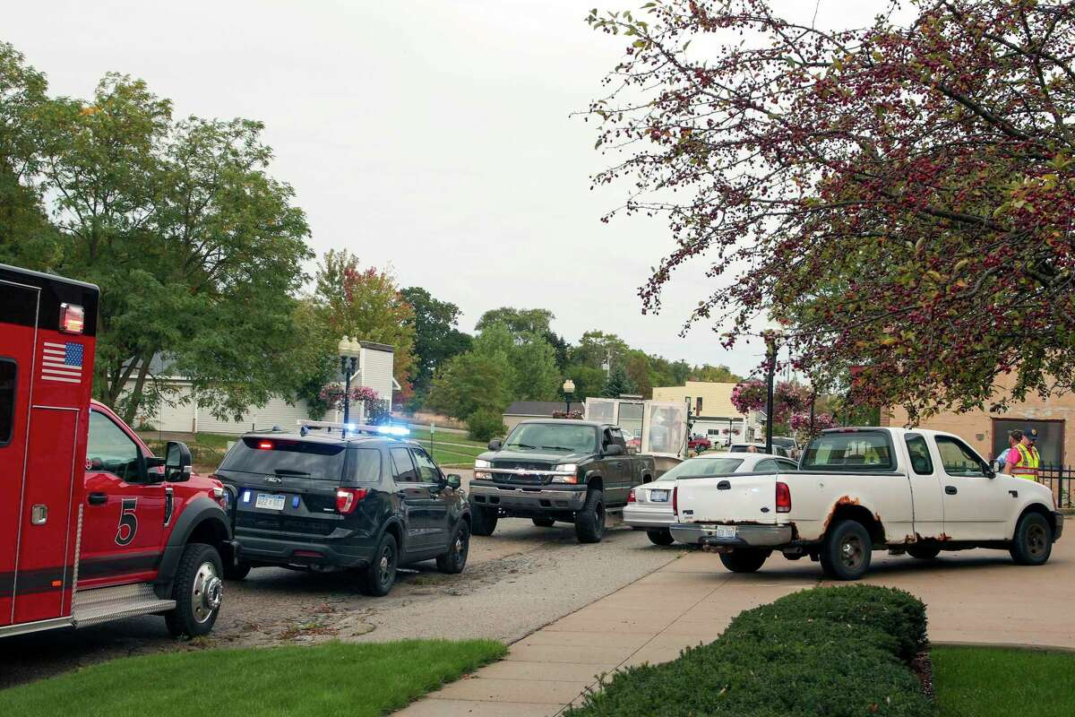 A vehicle crash occurred between a truck and sedan at the corner of Washington and Memorialon Thursday. Minor injuries were reported. (Jeff Zide/News Advocate)