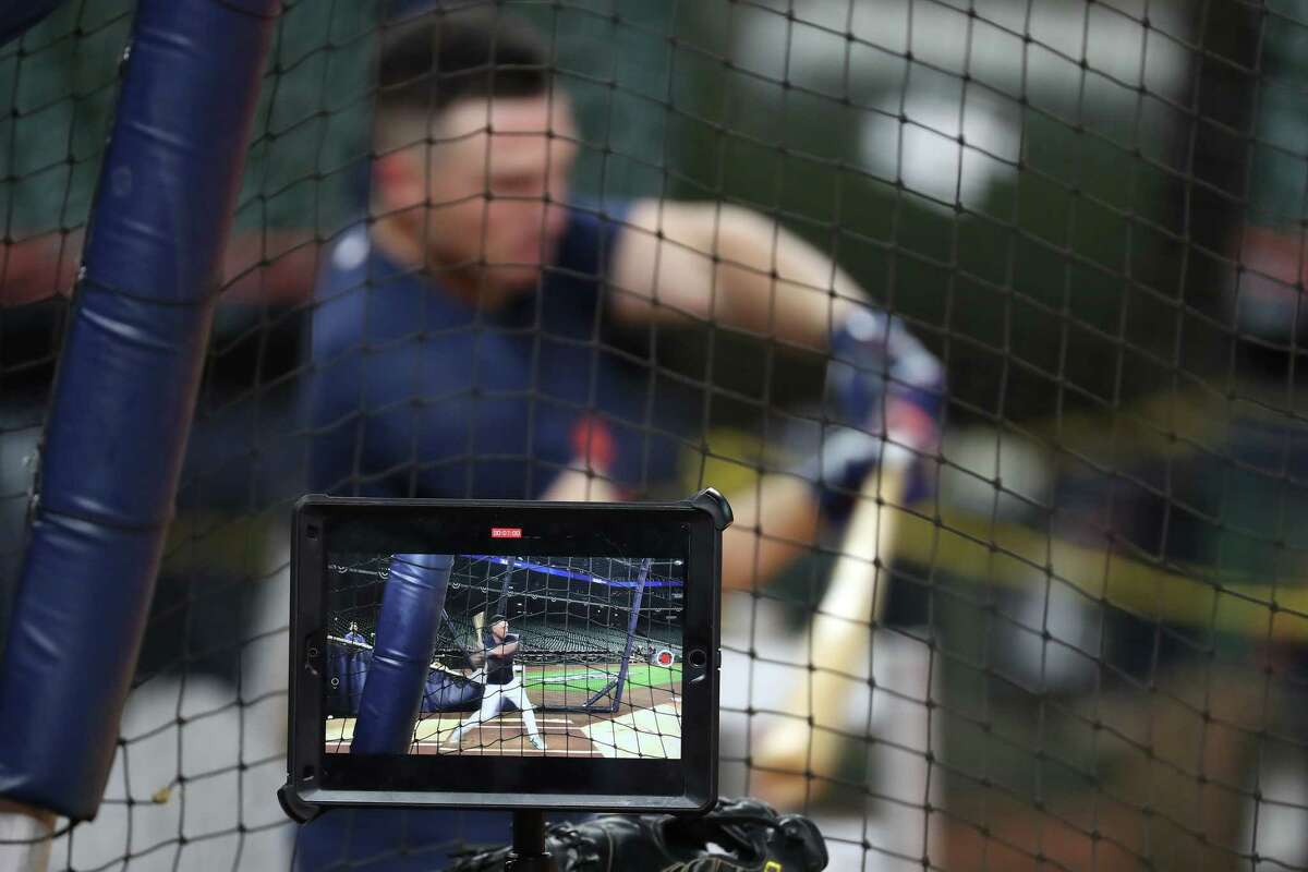 Houston Astros third baseman Alex Bregman is shown on a video screen as he takes batting practice during a workout the day before Game 1 of the American League Championship Series against the Boston Red Sox Thursday, Oct. 14, 2021 in Houston.