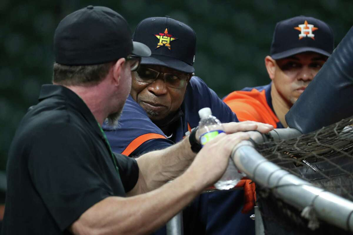 Houston Astros manager Dusty Baker Jr., center, talks to former Astros first baseman and Hall of Famer Jeff Bagwell during batting practice the day before Game 1 of the American League Championship Series against the Boston Red Sox Thursday, Oct. 14, 2021 in Houston.