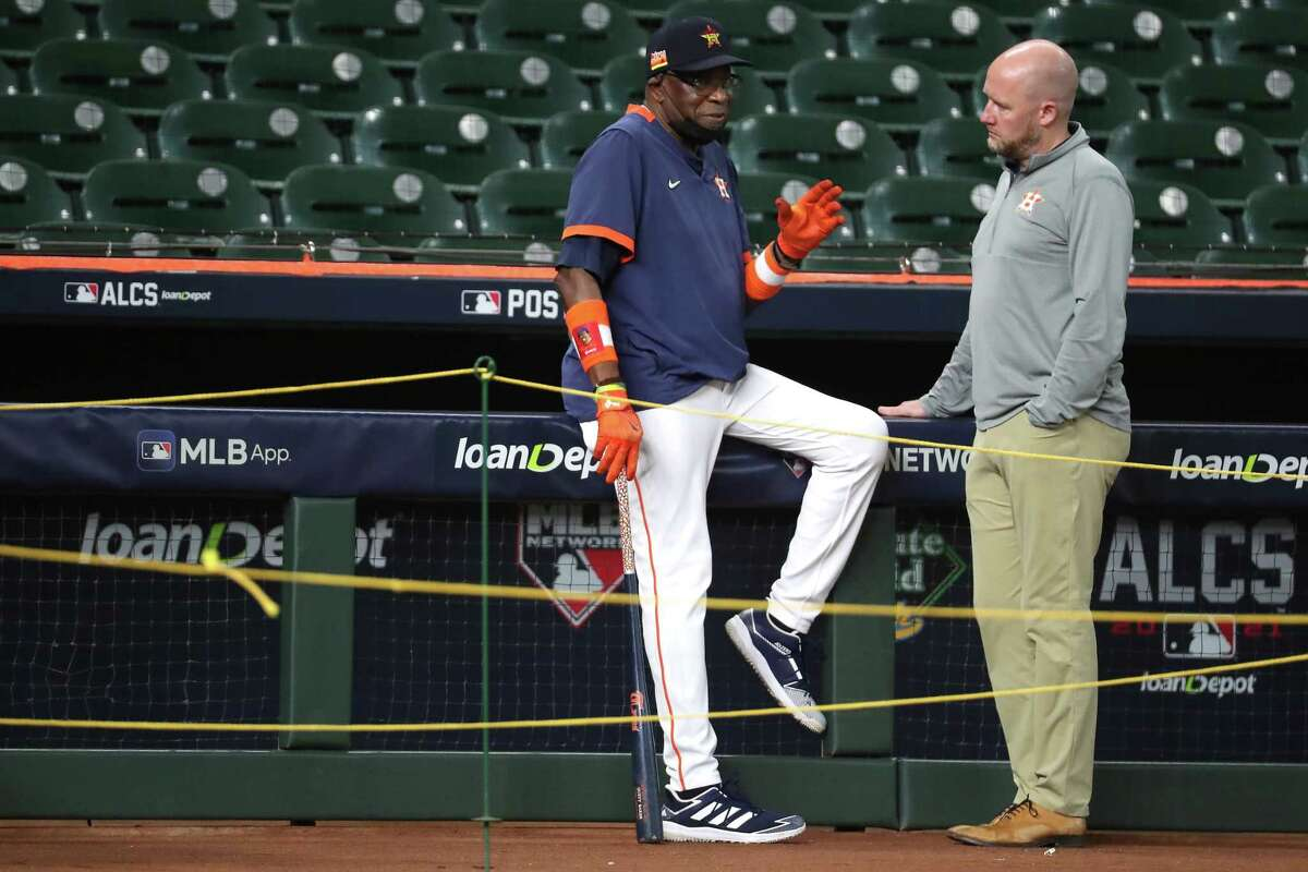Houston Astros manager Dusty Baker Jr., left, and general manager James Click talk near the third base dugout during a workout before Game 1 of the American League Championship Series against the Boston Red Sox Thursday, Oct. 14, 2021 in Houston.