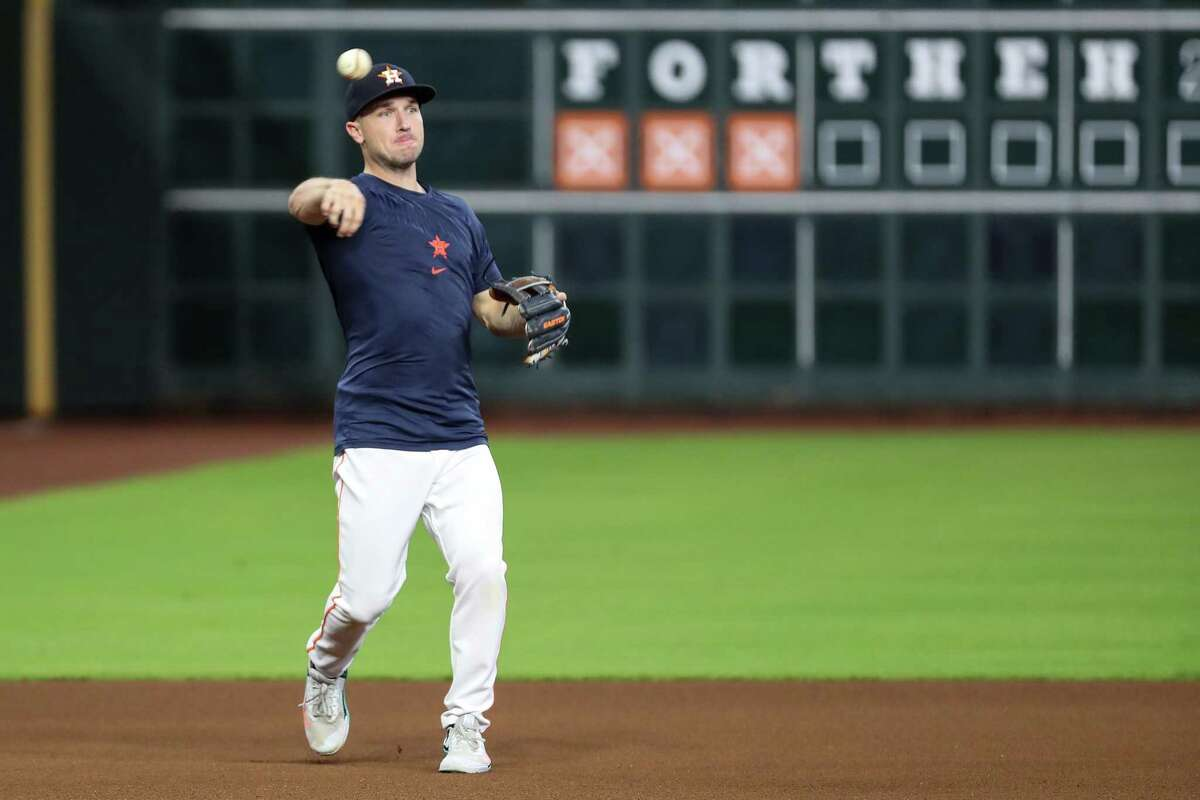 Houston Astros third baseman Alex Bregman makes a throw during a workout before Game 1 of the American League Championship Series against the Boston Red Sox Thursday, Oct. 14, 2021 in Houston.