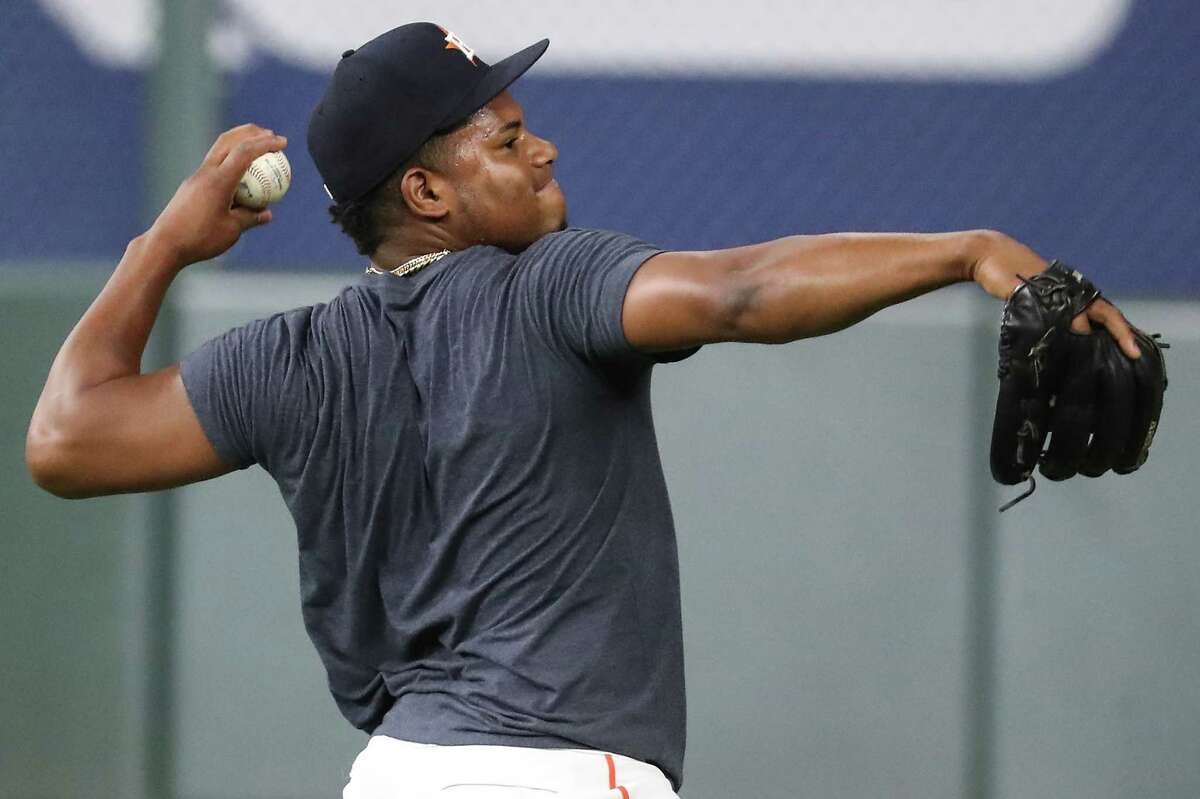Framber Valdez, getting in some work at Thursday's workout at Minute Maid Park, will start Game 1 of the ALCS against Boston on Friday night.
