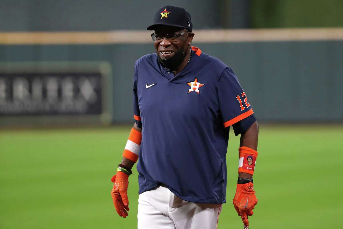 Houston Astros manager Dusty Baker Jr. walks onto the field during a workout the day before Game 1 of the American League Championship Series against the Boston Red Sox Thursday, Oct. 14, 2021 in Houston.