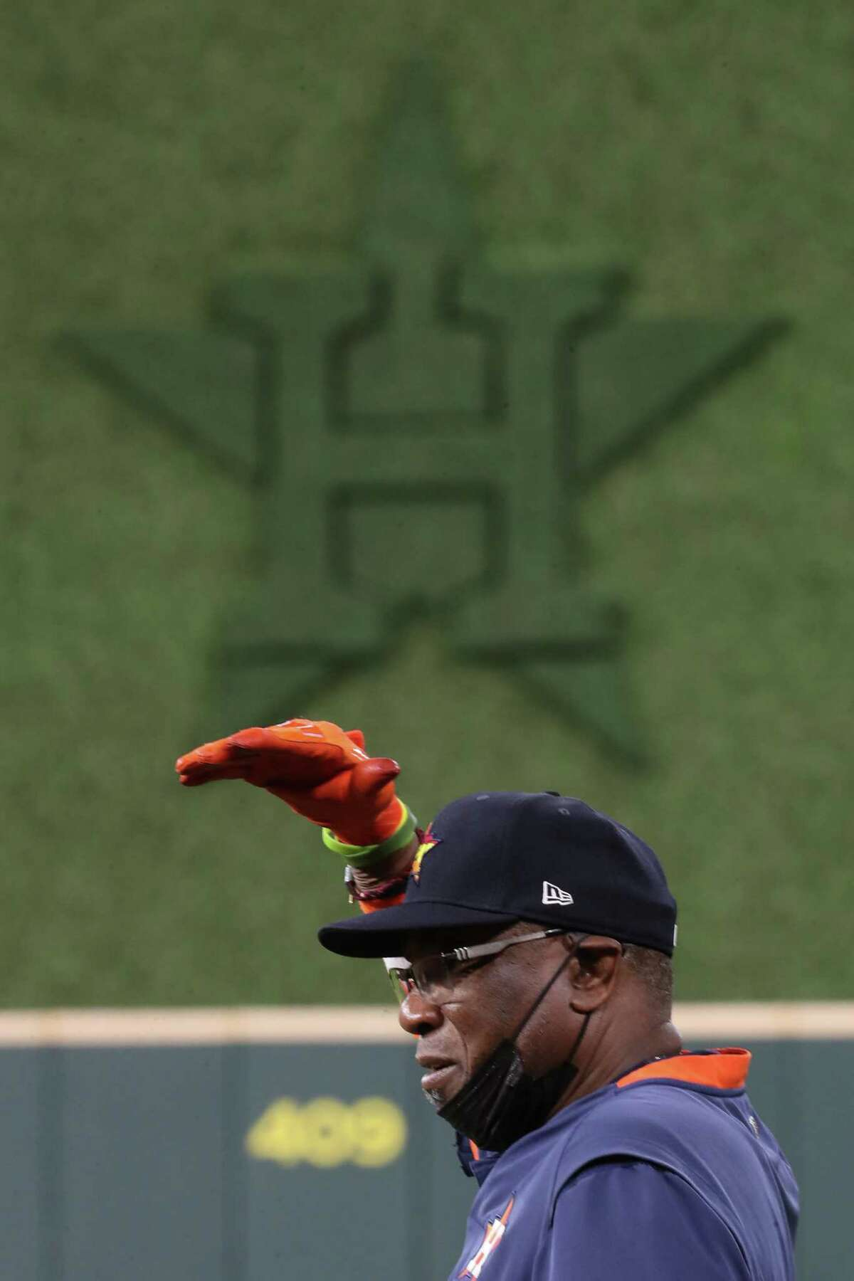 Houston Astros manager Dusty Baker Jr. talks to his players on the field during a workout the day before Game 1 of the American League Championship Series against the Boston Red Sox Thursday, Oct. 14, 2021 in Houston.