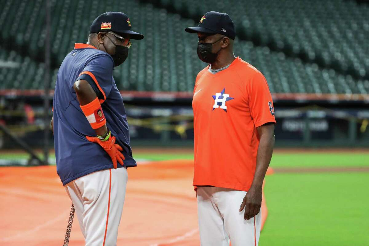 Houston Astros manager Dusty Baker Jr., left, and coach Gary Pettis (8) talk on the field during a workout the day before Game 1 of the American League Championship Series against the Boston Red Sox Thursday, Oct. 14, 2021 in Houston.
