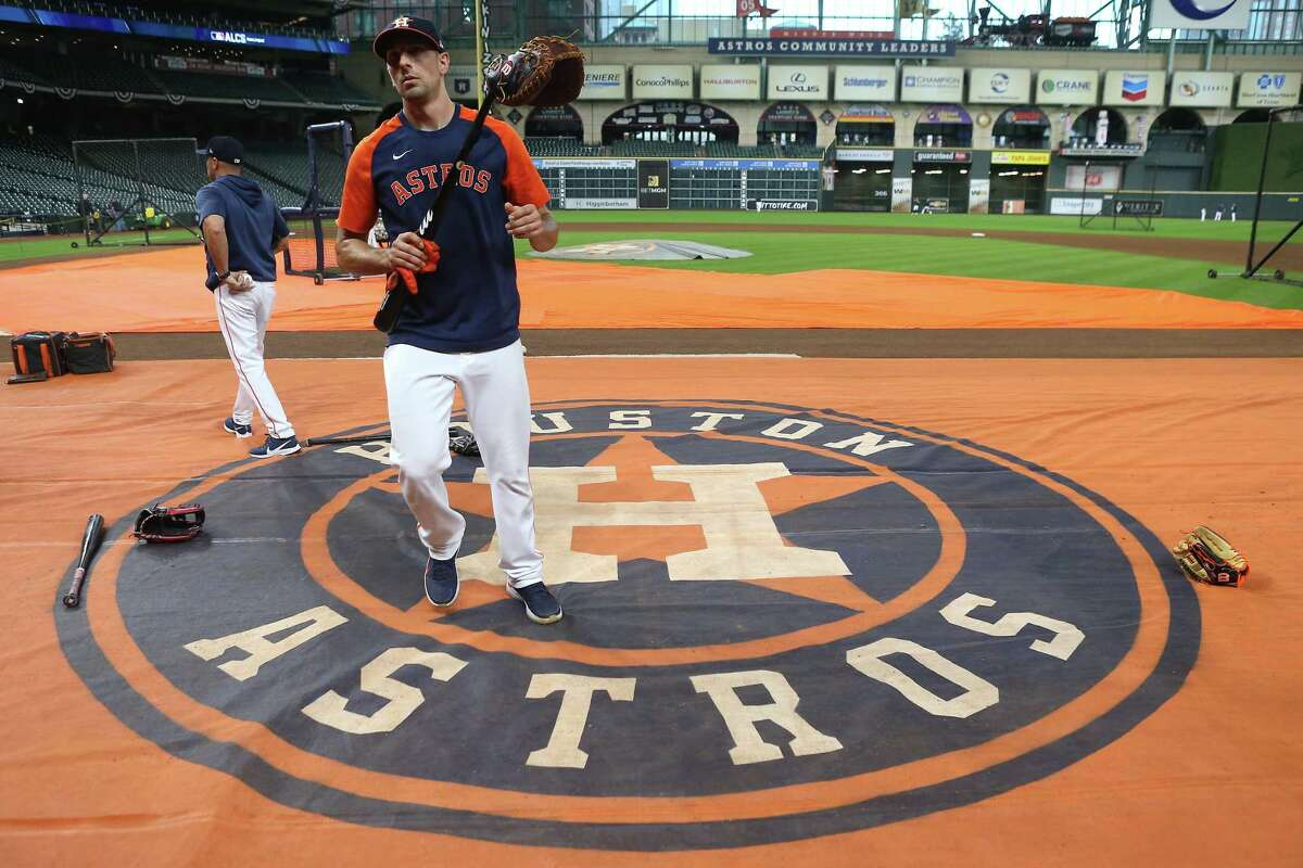 Houston Astros catcher Jason Castro walks off the field after taking batting practice during a workout before Game 1 of the American League Championship Series against the Boston Red Sox Thursday, Oct. 14, 2021 in Houston.