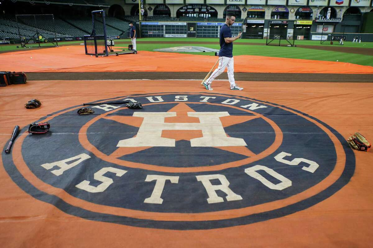 Houston Astros third baseman Alex Bregman walks on the field during a workout before Game 1 of the American League Championship Series against the Boston Red Sox Thursday, Oct. 14, 2021 in Houston.