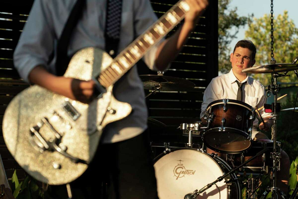 Solomon Levin, 13, plays drums during a concert of his band Sini Nomine at Betsy's in Evelyn's Park on October 8, 2021 in Houston, Texas. The band play at Betsy's in Evelyn's Park as a part of their bar mitzvah project,