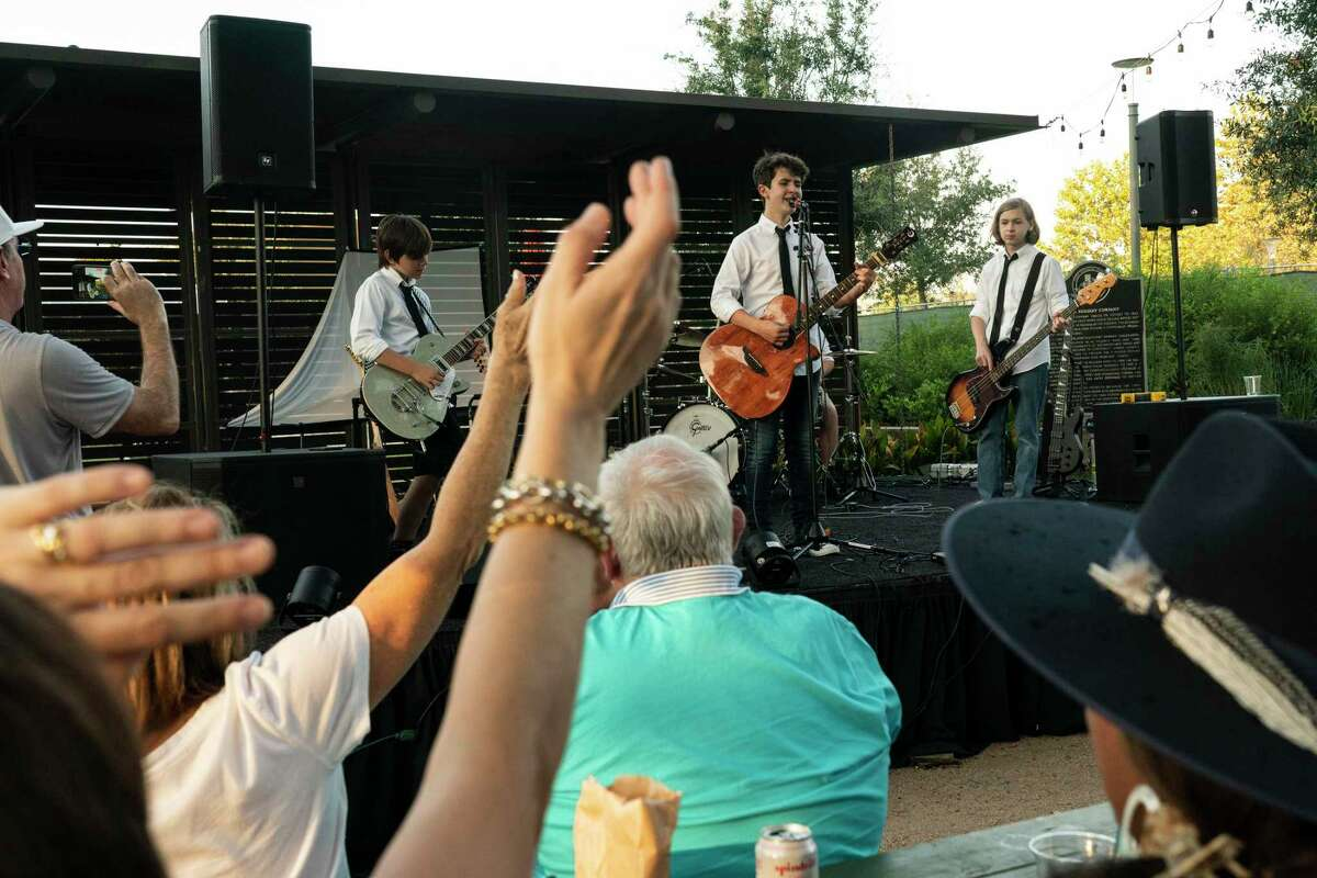 The band Sini Nomine play in front of audiences at Betsy's in Evelyn's Park on October 8, 2021 in Houston, Texas. The band play at Betsy's in Evelyn's Park as a part of their bar mitzvah project,