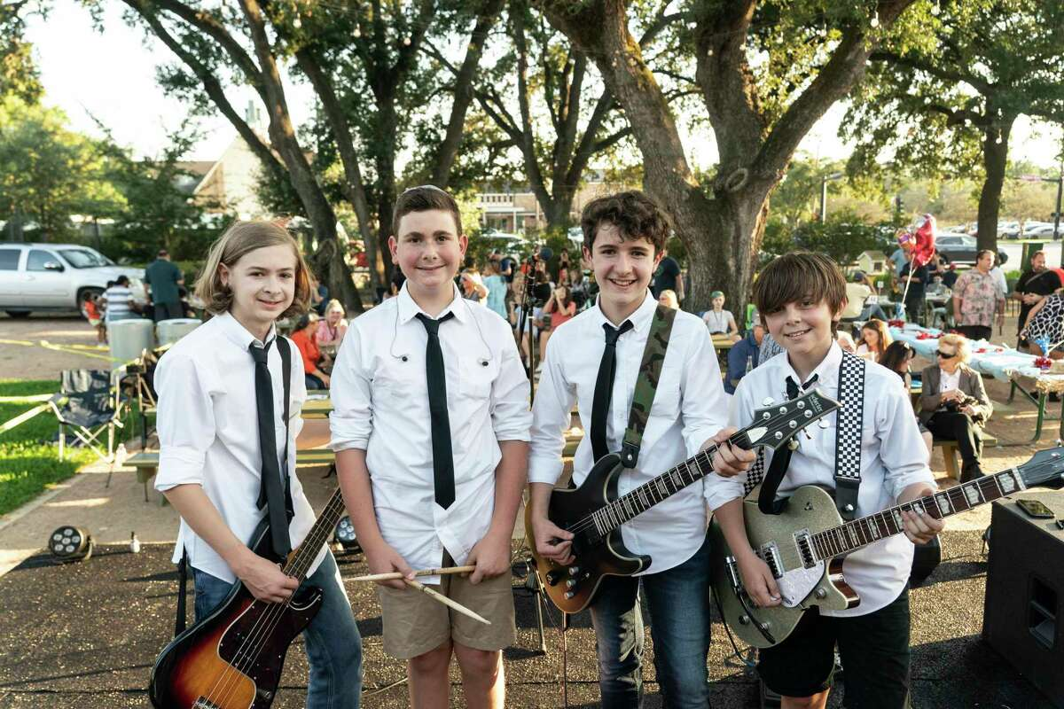 Band members of Sini Nomine Ryder Panton, 12, Solomon Levin, 13, Lucas Wilson, 13, and George Fellows, 13, pose at Betsy's in Evelyn's Park on October 8, 2021 in Houston, Texas. The band play at Betsy's in Evelyn's Park as a part of their bar mitzvah project,