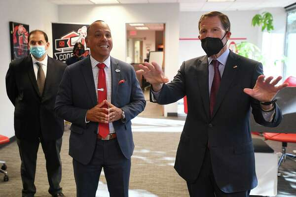 Ramon Peralta, center, gives a tour of Peralta Design to Senator Richard Blumenthal during his visit to the business in Shelton, Conn. on Tuesday, October 12, 2021. Blumenthal was visiting to coincide with the creation of a Connecticut minority business development center.
