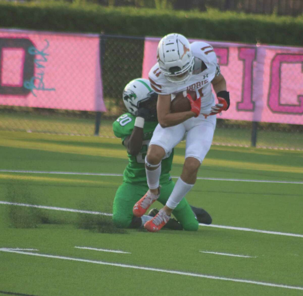 Dobie's Joshua Rodriguez gets dragged into the end zone for a score after a pass completion. That's not what the Longhorns like best, but they've got the receivers to give them another layer of weapons.