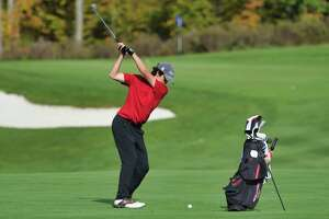 Vincent Liquori of Niskayuna swings back to hit a shot towards the green during the Section II Class A boy's golf tournament at Fairways of Halfmoon on Thursday, Oct. 14, 2021, in Mechanicville, N.Y.