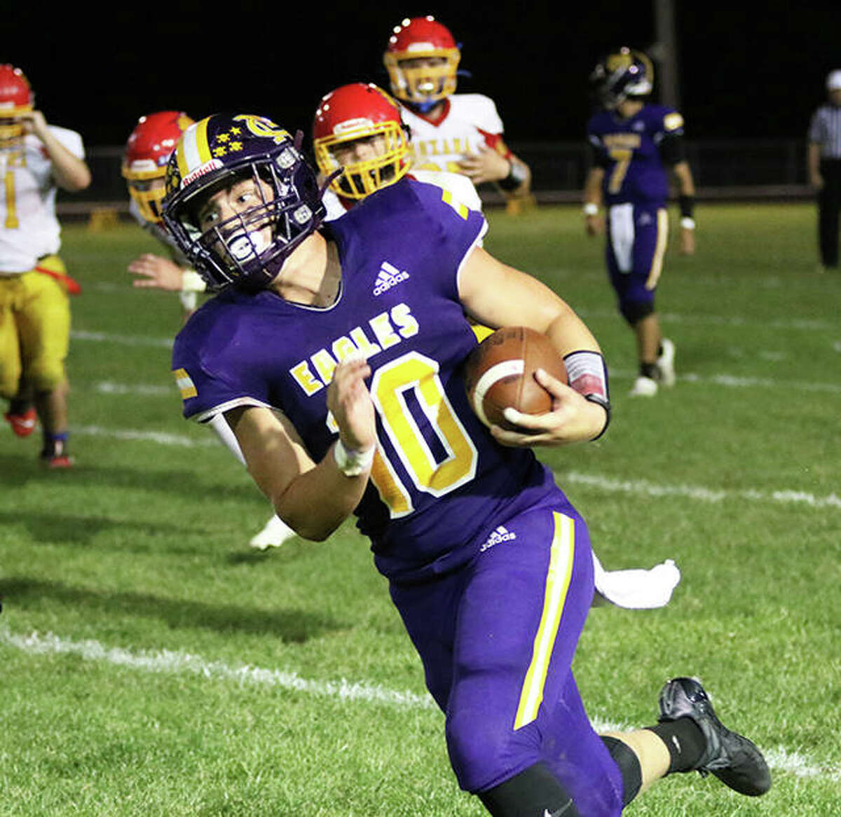 CM's Nick Brousseau (10) picks up yardage in a game against Roxana on Sept. 10 in Bethalto. The Eagles are on the road Friday to play rival Jersey in a MVC game in Jerseyville.