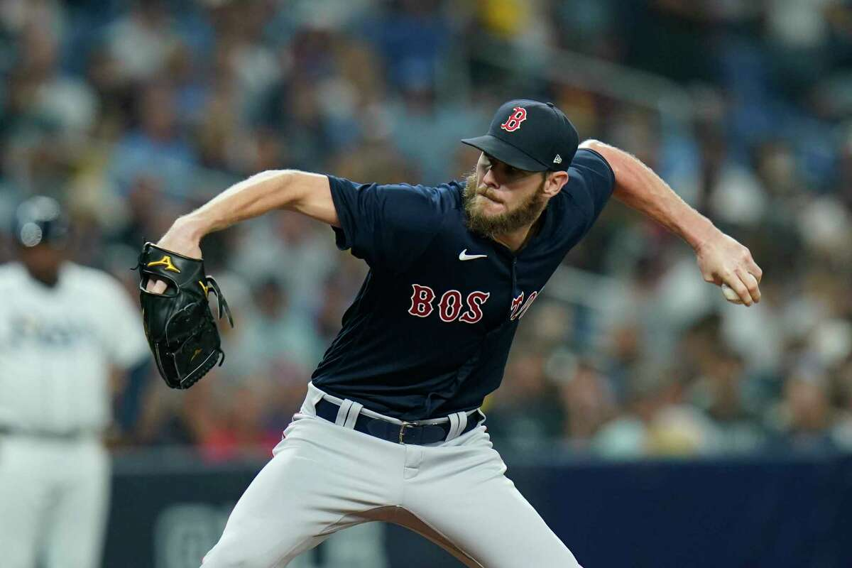 Boston Red Sox starting pitcher Chris Sale throws against the Tampa Bay Rays in the first inning Game 2 of a baseball American League Division Series, Friday, Oct. 8, 2021, in St. Petersburg, Fla. (AP Photo/Chris O'Meara)