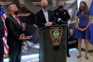 Mayor Harry Rilling joined members for the Norwalk Police Department and Wilton Quaker Meeting members Peter Murchison and Diane Keefe to announce Saturday's community gun buyback event in Norwalk on Thursday, Oct. 14 at the Norwalk Police station. Rilling was presented with two gardening tools forged from guns collected during the 2019 buyback.