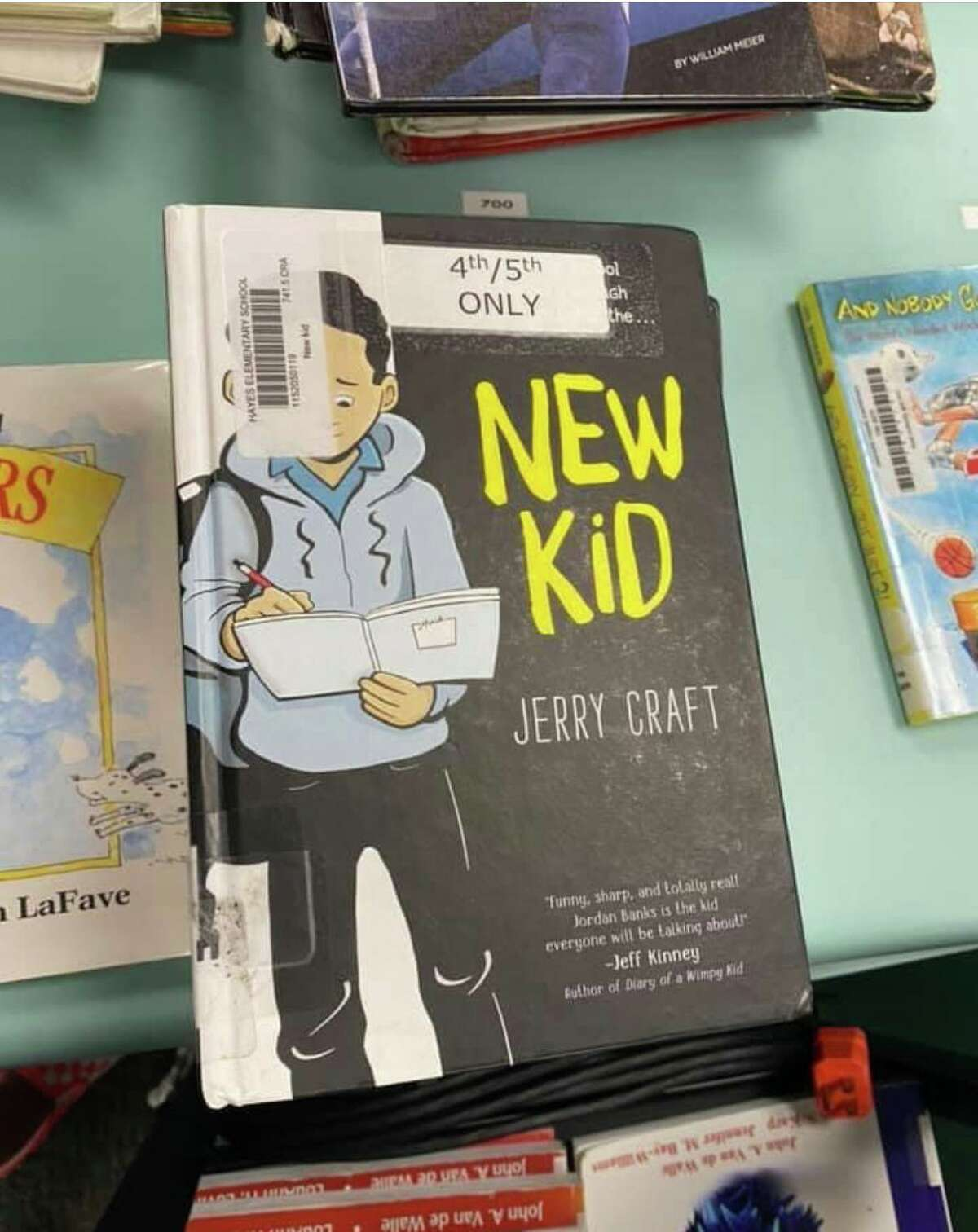 Jerry Craft's graphic novels are back on Katy ISD library shelves after a review committee found the claims against them baseless.