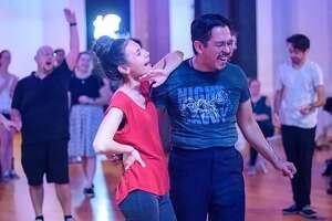 Hana Buck and Rolando Almaraz, pictured above, are veteran swing dancers.