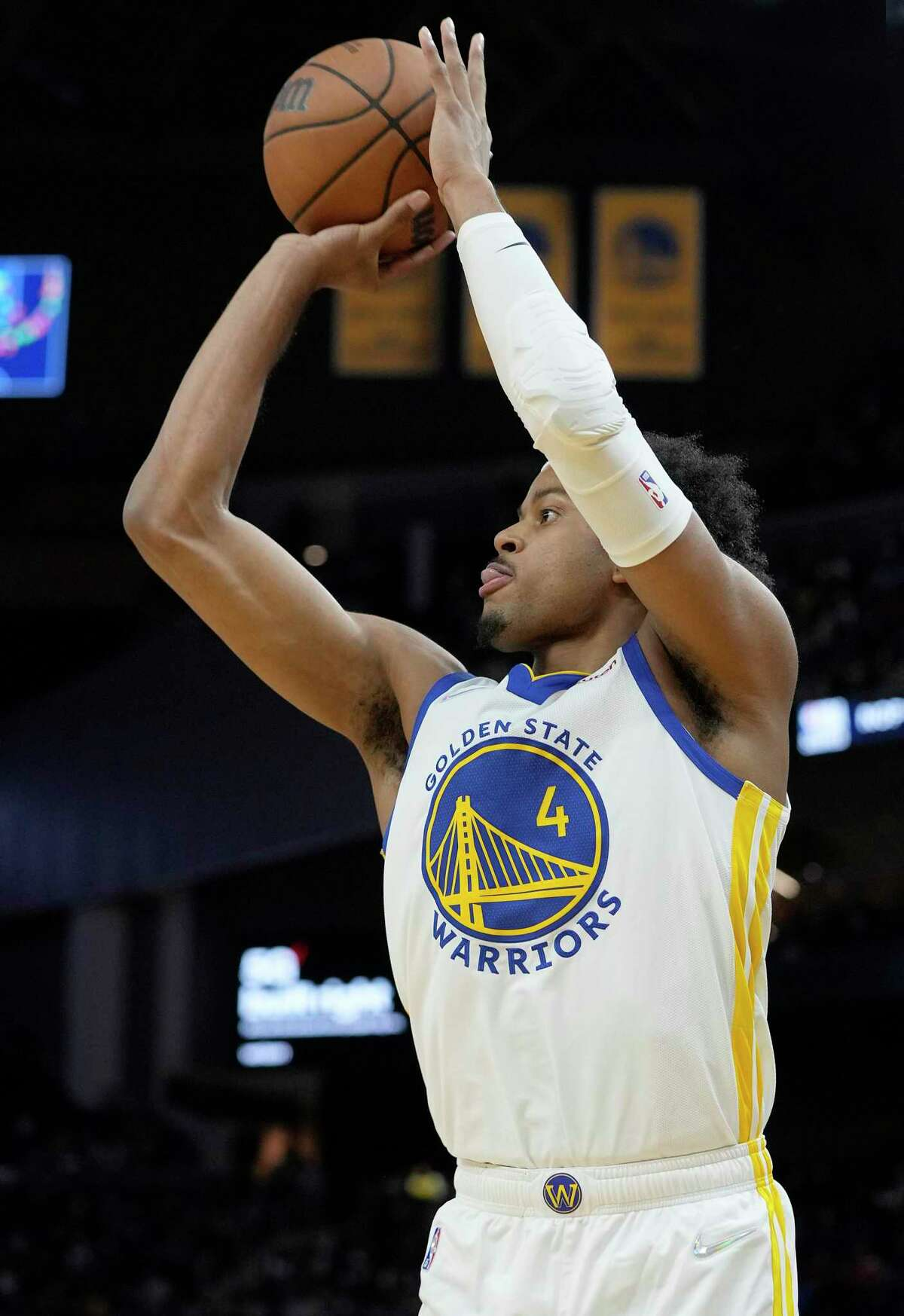 SAN FRANCISCO, CALIFORNIA - OCTOBER 08: Moses Moody #4 of the Golden State Warriors shoots a three-point shot against the Los Angeles Lakers at Chase Center on October 08, 2021 in San Francisco, California. NOTE TO USER: User expressly acknowledges and agrees that, by downloading and/or using this photograph, User is consenting to the terms and conditions of the Getty Images License Agreement. (Photo by Thearon W. Henderson/Getty Images)