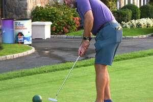 Tim Oberweger hosted the recent CLC Golf Outing in Glenville, which benefited the Children's Learning Centers of Fairfield County, and he also took part in the putting contest. The event raised more than $100,000 for the nonprofit.