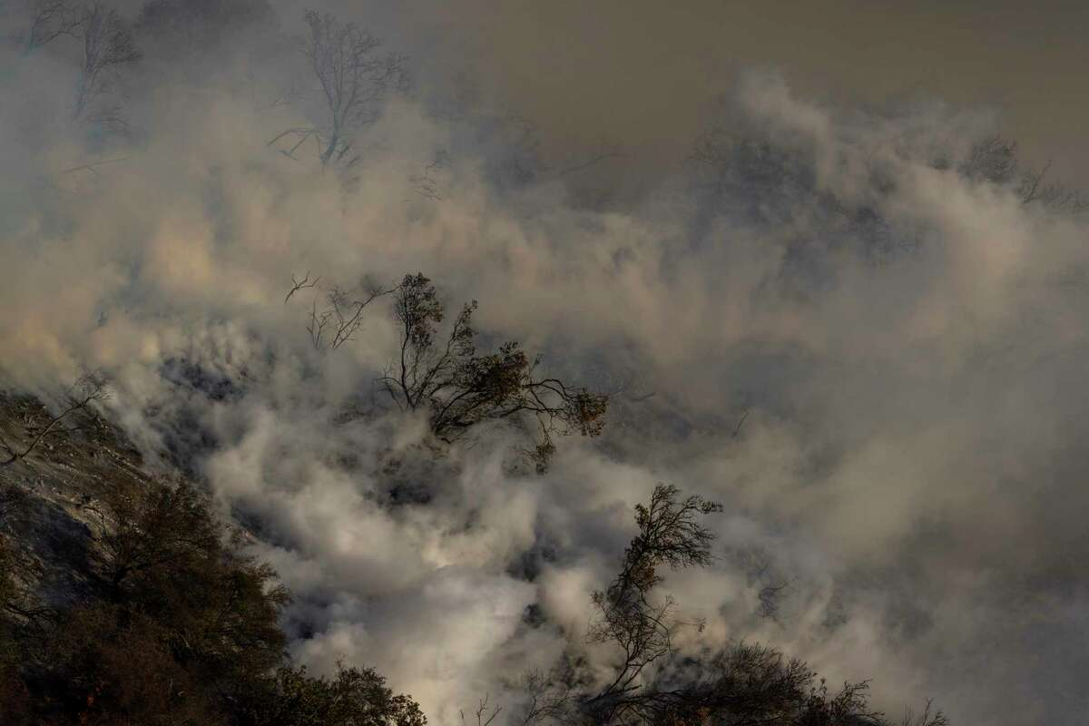 Steam rises from hot ground after a firefighting helicopter makes a water drop Wednesday at the Alisal Fire.