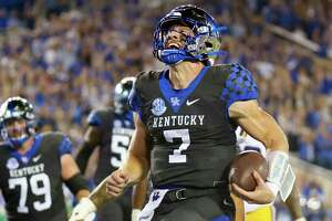 Kentucky quarterback Will Levis (7) carries the ball into the end zone for a touchdown during an NCAA college football game against LSU in Lexington, Ky., Saturday, Oct. 9, 2021. (AP Photo/Michael Clubb)
