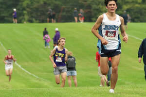 Jersey's Cole Martinez (right) approaches the finish to place third ahead of CM's Jackson Collman in the Mississippi Valley Conference Meet on Thursday at Principia College in Elsah.