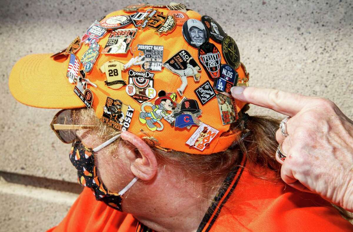 Giants pins cover the cap of fan Laurie Gratiot. He's been collecting the pins for more than 25 years. He watched the Giants play the Yankees in the 1962 World Series.