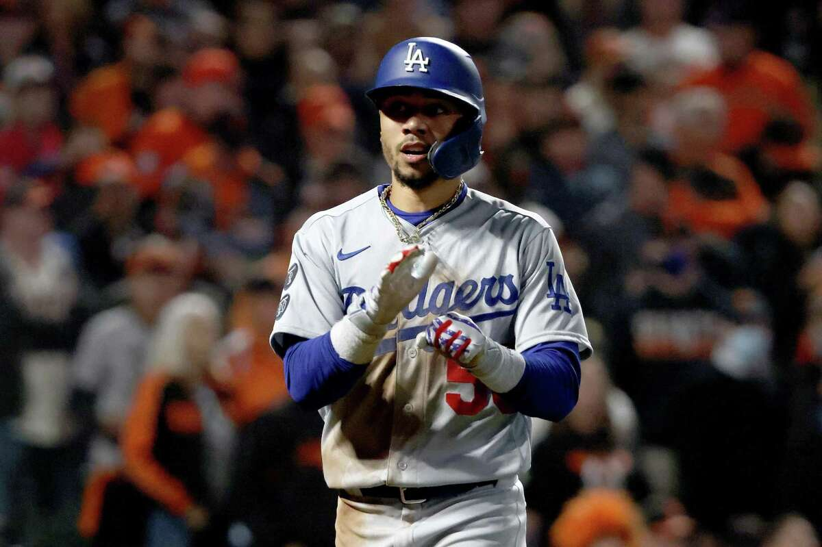 SAN FRANCISCO, CALIFORNIA - OCTOBER 14: Mookie Betts #50 of the Los Angeles Dodgers celebrates his run on an RBI double by Corey Seager #5 against the San Francisco Giants during the sixth inning in game 5 of the National League Division Series at Oracle Park on October 14, 2021 in San Francisco, California. (Photo by Harry How/Getty Images)