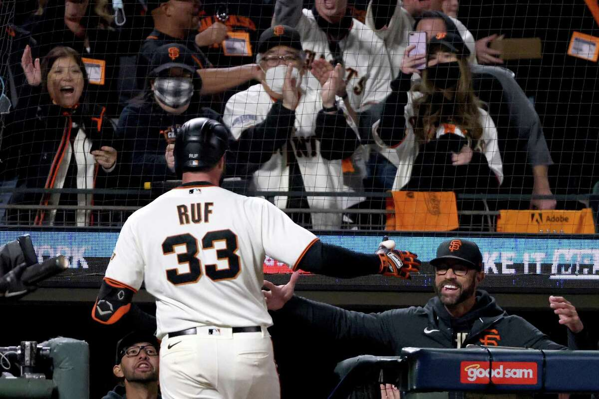 SAN FRANCISCO, CALIFORNIA - OCTOBER 14: Darin Ruf #33 and manager Gabe Kapler #19 of the San Francisco Giants celebrate Ruf's solo home run against the Los Angeles Dodgers during the sixth inning in game 5 of the National League Division Series at Oracle Park on October 14, 2021 in San Francisco, California. (Photo by Harry How/Getty Images)