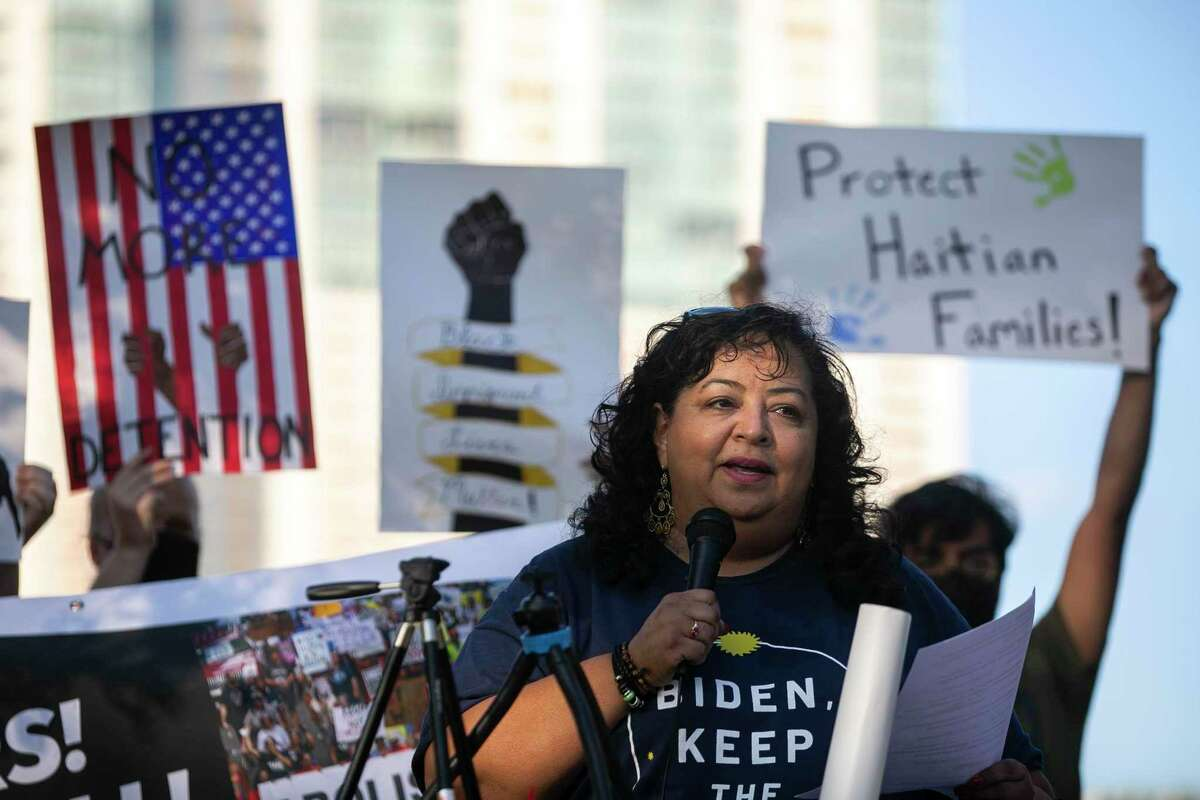 Debra Ponce of RAICES speaks during a rally held Thursday evening on the steps of the John H. Wood Jr. U.S. Courthouse downtown. About 30 people participated in the event held as part of a national day of protest.