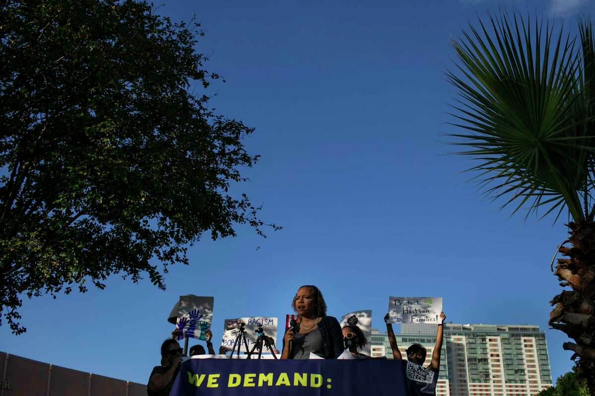 Nichole Morgan, an attorney with RAICES, speaks during the rally held to stand in solidarity with Black migrants and share the demands of Haitian asylum seekers.