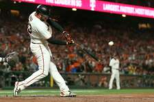 San Francisco Giants' Darin Ruf hits a home run against the Los Angeles Dodgers during the sixth inning of Game 5 of a baseball National League Division Series Thursday, Oct. 14, 2021, in San Francisco. (AP Photo/Jed Jacobsohn)